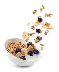 Bowl with tasty granola, yogurt and fruits on white background