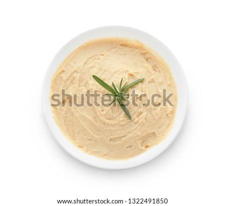 Bowl with tasty hummus on white background ストックフォト ©
