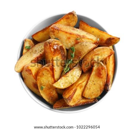 Bowl with tasty potato wedges on white background Stock photo ©