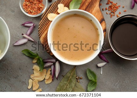 Bowl with turkey gravy and spices on grey table Сток-фото ©