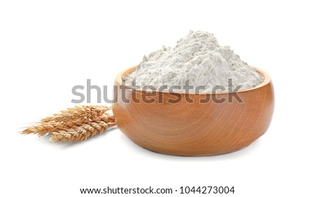 Bowl with wheat flour and spikelets on white background #1044273004