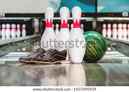 bowling ball and pins and shoes