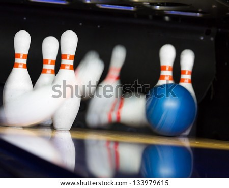 Bowling ball hitting motion blurred pins