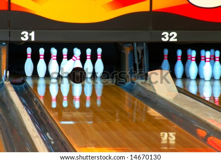 Bowling ball making contact with head pin in the strike zone.