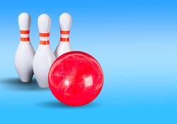 Bowling. Bowling ball and bowling pins on a beautiful light blue background. Place for your inscription. Copy space