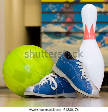 Bowling pins, shoes and ball