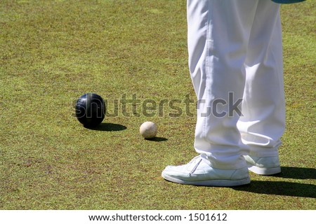 Bowling player and balls, on the playing ground