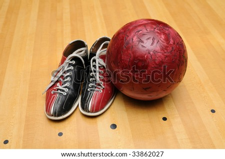 Bowling shoes and ball on the lane