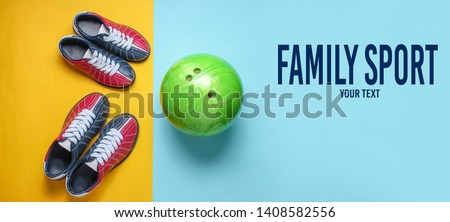 Bowling shoes and bowling ball on blue yellow background. Indoor family sports. Copy space