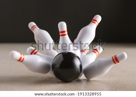 Bowling strike hit on dark background. Minimal concept of success and win. Stock photo ©
