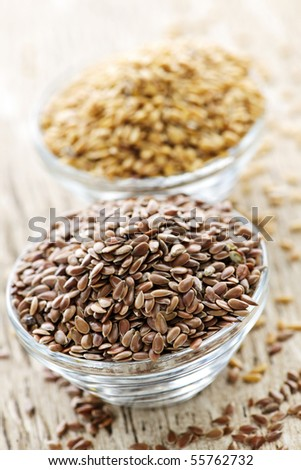 Bowls full of brown and golden flax seed or linseed