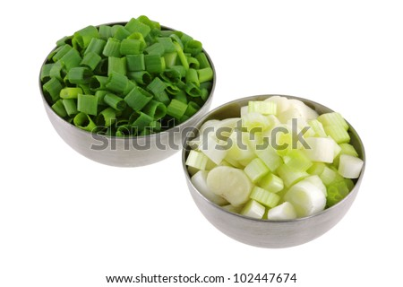 Bowls of Chopped Spring Onion separated into green leaves and white bulbs, isolated on white background - stock photo