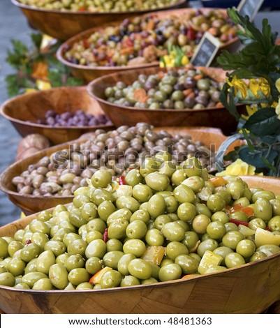 Bowls of olives for sale at a market