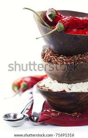 Bowls of uncooked rice over white