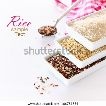 bowls of uncooked rice over white background