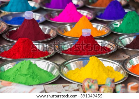 Bowls of vibrant colored dyes in India - holi colors.