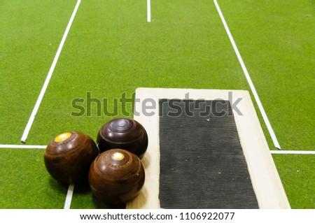 Bowls on an indoor bowls carpet #1106922077