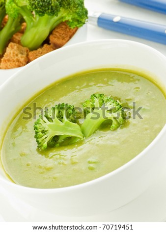 Bowls with green broccoli soup. Shallow dof.
