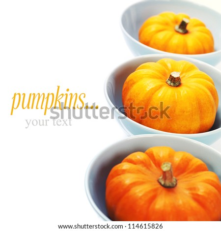 bowls with pumpkins over white. With easy removable sample text