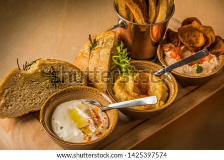 bowls with sauce dips potatoes and bread #1425397574