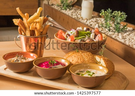 bowls with sauce dips potatoes and bread #1425397577