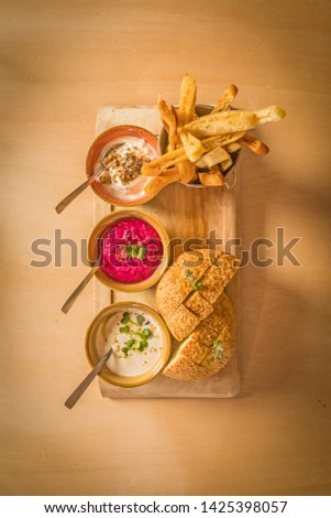bowls with sauce dips potatoes and bread #1425398057