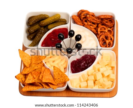 Bowls with snacks on bamboo tray isolated on white background
