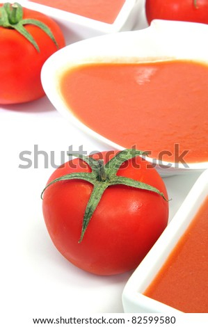 bowls with spanish gazpacho on a white background