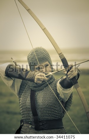 stock photo : bows woman / medieval armor / historical story  / retro split toned