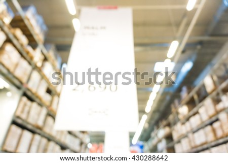 Box blurred image of shopping mall with row of shelf in big store