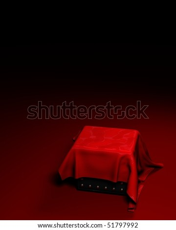box covered with red cloth on a dark background