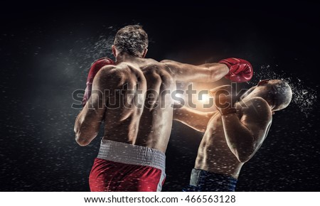 Photo of  Box fighters trainning outdoor . Mixed media