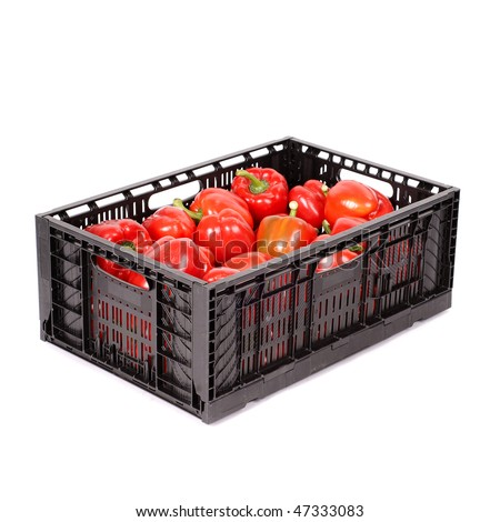 Box full of fresh red peppers isolated on white
