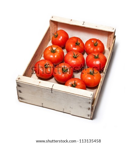 Box of beef tomato's isolated on a white studio background.