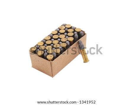 box of .22 caliber bullets one round leaning against box  isolated white background