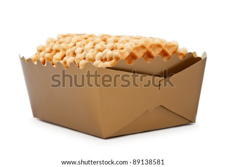 Box of crispy waffles isolated over white background