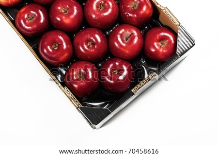 Box of fresh red apples isolated on white background