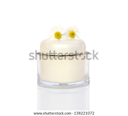 Box of natural cream with chamomile flowers