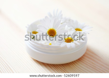 box of natural cream with chamomille flowers - beauty treatment