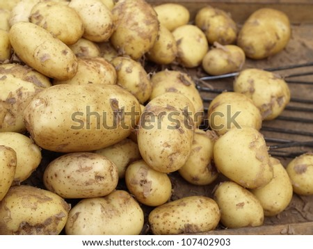 Box of potatoes on outside grocery stall