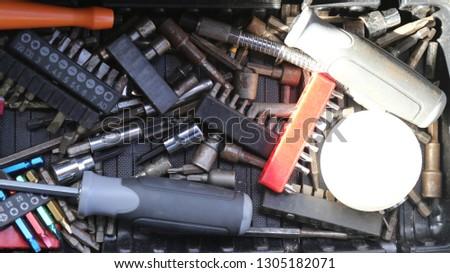 Box of screwdriver bits. Phillips screwdriver and flat head screwdriver.