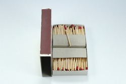 Box of wood match stick on the white background. Old technology of lid the fire or lighting the flame in Asia.