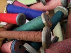 box of yarns and threads on bobbins