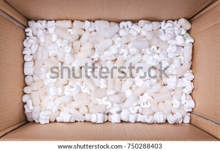 box packaging with polystyrene peanuts inside