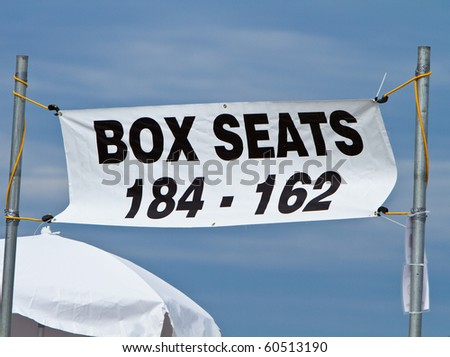 Box seats section market by a banner