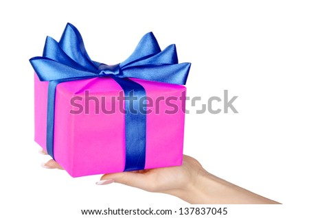 Box with a gift in the hands of women. Isolated on white background.