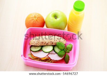 box with delicious sandwich and some fruits - food and drink