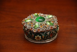 Box with jewels of yellow and green colors, antiques