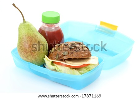box with lunch - delicious sandwich and fruit close-ups
