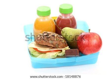 box with lunch - delicious sandwich and fruits close-ups